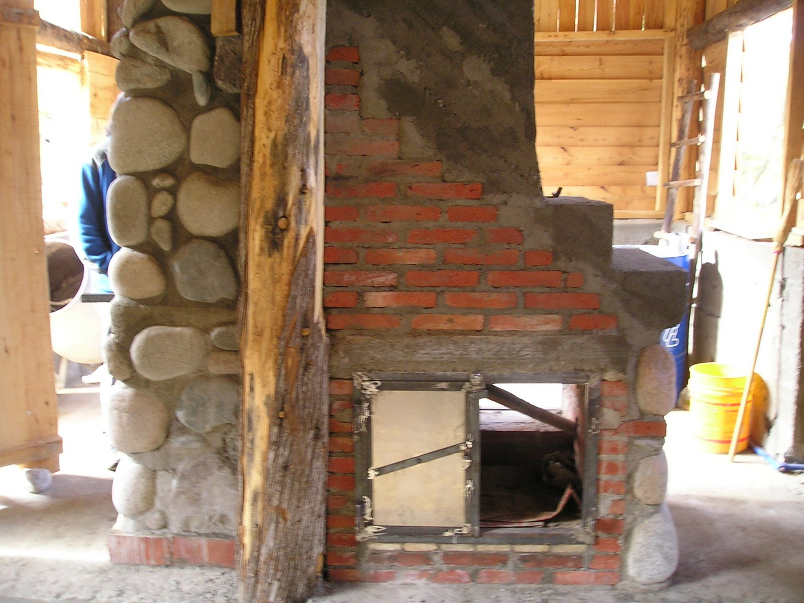 fireplace mass stove oven water heater and staircase all in