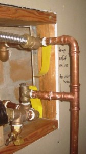details of plumbing coming out of firebox